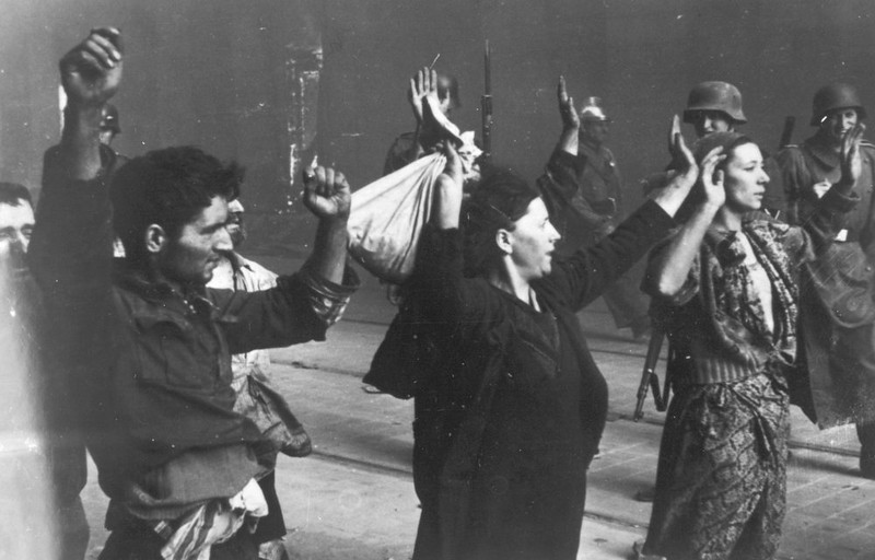 . A group of Polish Jews are being held at gunpoint by German SS soldiers, April/May 1943, during the destruction of the Warsaw Ghetto by German troops after an uprising in the Jewish quarter. (AP Photo)