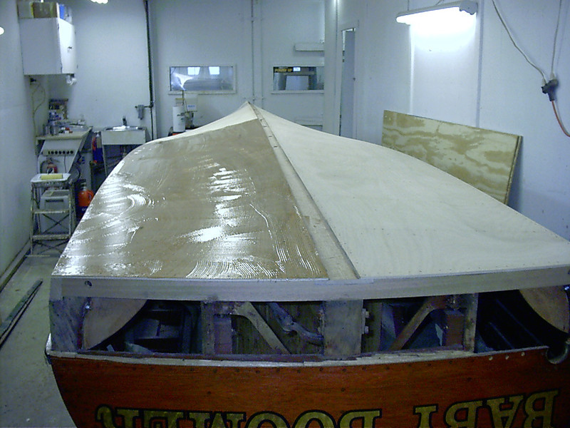 Applying epoxy to bottom to glue second layer in place.