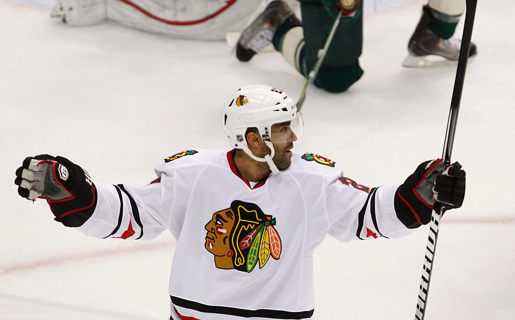 . Chicago\'s Johnny Oduya celebrates his goal against Wild goalie Josh Harding in the first period. (AP Photo/Andy King)