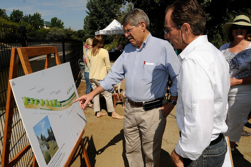 . LA County Supervisor Zev Yaroslavsky looks at a plan with Rick Rabins from the Village Gardeners of the Los Angeles River before they broke ground for North Valleyheart Riverwalk project. The plan is to beautify and improve the ½ mile concrete channel that boarders Valleyheart Drive between Fulton and Coldwater Canyon Avenues. Studio City, CA. 7/13/2013(John McCoy/LA Daily News)