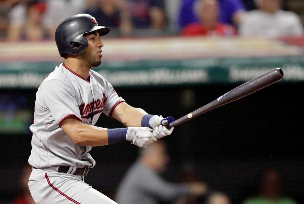 . Minnesota Twins\' Eddie Rosario watches his ball after hitting a one-run double off Cleveland Indians starting pitcher Adam Plutko in the fifth inning of a baseball game, Wednesday, Aug. 29, 2018, in Cleveland. (AP Photo/Tony Dejak)