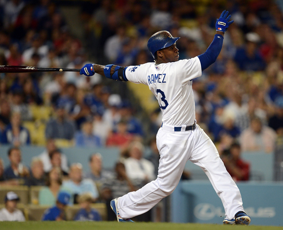 . The Dodgers\' Hanley Ramirez #13 slugs a 2-run homer in the 4th inning during game against the Red Sox at Dodger Stadium Friday, August 23, 2013 in Los Angeles. (Hans Gutknecht/Los Angeles Daily News)