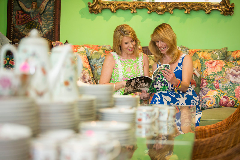 Photo: Jacek Gancarz. Caption: Friday, February 21, 2014 - Photo: Jacek Gancarz. Caption: Friday, February 21, 2014, L-R, Susan Trader of Cape Coral, Fla. and Michele Baymor of Philadelphia, look through a catalog during a preview of property from the estate of Lilly Pulitzer of Palm Beach, Fla. The auction takes place on Saturday, February 22, 2014.