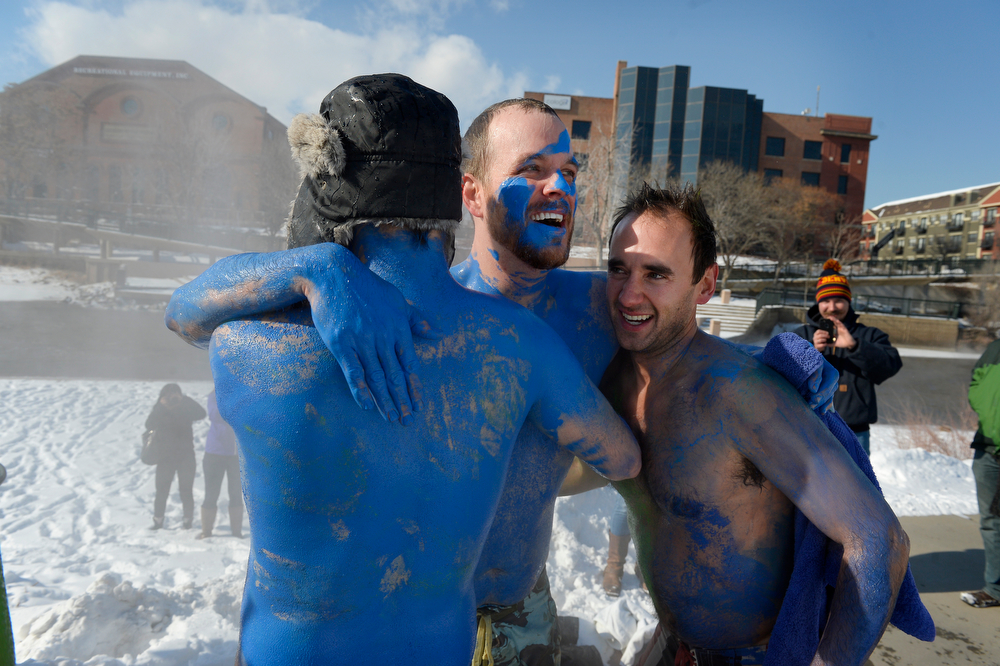 . Denver Beer Co. brewers (l-r) Austin Wiley, Nick Bruno and Patrick Crawford embrace taking a plunge in the South Platte River at Confluence Park in Denver, CO February 06, 2014. (Photo By Craig F. Walker / The Denver Post)