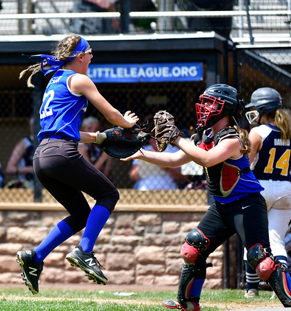 7/25/2019 Mike Orazzi | Staff Pennsylvania's Abby Lorson (22) and Lily Reidy (7) celebrate a 3-2 win over Connecticut during the Eastern Regional Softball Tournament at Breen Field in