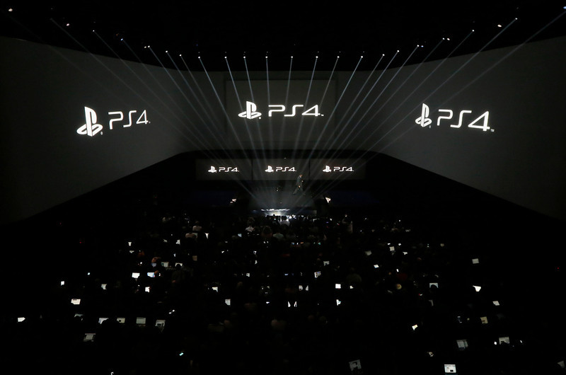. People attend the PlayStation 4 launch event in New York, February 20, 2013. REUTERS/Brendan McDermid