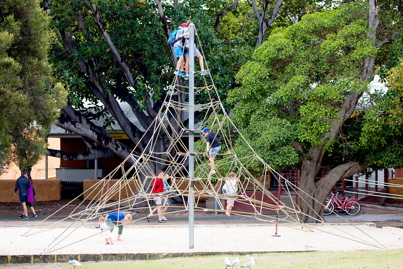 Local kids in a rather remarkable playground device.