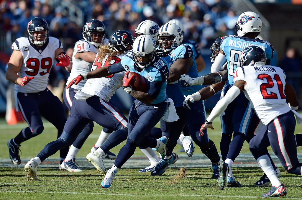 . Tennessee Titans running back Chris Johnson (28) carries the ball as Houston Texans cornerback Brice McCain (21) closes in during the second quarter of an NFL football game Sunday, Dec. 29, 2013, in Nashville, Tenn. (AP Photo/Mark Zaleski)