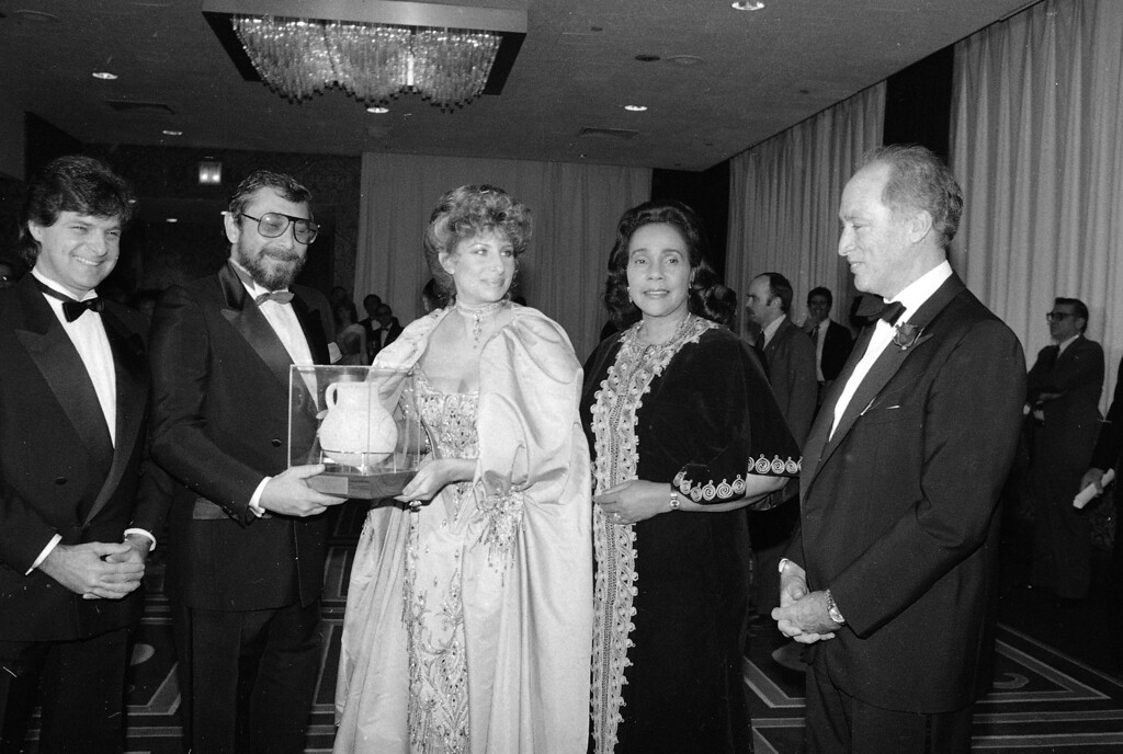 . Barbra Streisand, center, with Canadian Prime Minister Pierre Trudeau, at right, join Coretta Scott King at the United Jewish Appeal dinner in New York at the Sheraton Hotel  on October 29, 1983.  Two men at left are unidentified.   (AP Photo/David Gould)