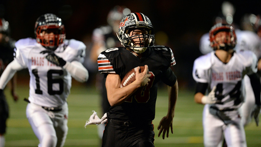 . Hart�s Connor Wingenroth #10 heads for the end zone on a 63-yard touchdown run during their CIF Northern Division playoff game against Palos Verdes  at College of the Canyons in Santa Clarita Friday November 22, 2013. (Photos by Hans Gutknecht/Los Angeles Daily News)