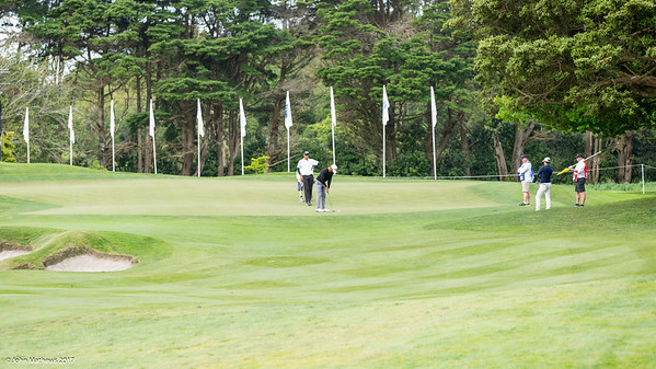 Players putting on the 16th green on the 1st day of competition in the Asia-Pacific Amateur Championship tournament 2017 held at Royal Wellington Golf Club, in Heretaunga, Upper Hutt, New Zealand from 26 - 29 October 2017. Copyright John Mathews 2017.   www.megasportmedia.co.nz