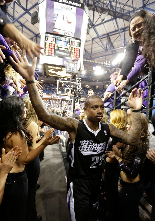 . Sacramento Kings guard Isaiah Thomas thanks the fans as he leaves the court after the Kings 112-108 loss to the Los Angeles Clippers  in an NBA basketball game in Sacramento, Calif., Wednesday,  April 17, 2013. With the pending sale of the team and possible move to Seattle, Wednesday\'s game might be the last in Sacramento.(AP Photo/Rich Pedroncelli)