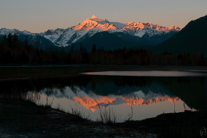 15 Jan 19Very late today; my apology. We got up way before the sun on Monday and headed for the North Cascades region of the state on our annual trek to that area to see what's there. It was the day after the annual Eagle Festival and apparently all the stars had checked out and gone on their way. We saw a total of 4 but as they weren't the reason for the trip it didn't matter. Had that been the number hanging out over the weekend I'm rather certain it would have been duly noted!! We were hoping for some white weather but instead were treated to lots of yellow weather and completely empty skies. That made for some challenging photography; very high contrast and nothing to counter it. But I still took couple hundred images including many from a few locations we hadn't visited in the past as well as some from areas we frequently visit. By the time we got back home we were tired, cold, and ready to crash. A few too many tasks for this morning added to the delay. But let's start with a shot that shows how we ended out shoot. I've shared shots from this spot before, but they have always been of the late afternoon type. So here is 7,853 foot Sloan Peak, not high enough to be considered a real mountain out here, just a foothill, but I'll wager a pretty good sized mountain for those of you on the right coast. The setting sun provided a subtle display of color all the way to dark; morning was just a bit more vibrant. We got to enjoy it all from before start to after finish. Kinda hard to beat a day like that and a much appreciated break from the rains. Today it is similar; tomorrow the rains are slated to return.  Other than a bit of straightening, this is what the camera recorded. Sunset on Sloan Peak  Nikon D500; 18 - 200; Aperture Priority;  ISO 640; 1/200 sec @ f / 9.