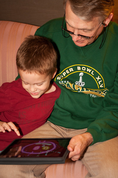 Howard snarfed down his food fast enough to find time to play with Aiden on his iPad.