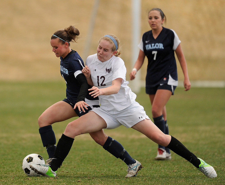 . PARKER, CO. - APRIL 2: Deomons midfielder Emily Oltmans (12) tried to push Valor midfielder Rachael Collins (2) off the ball in the first half. The Valor Christian High School girl\'s soccer team defeated Golden 4-1 Wednesday night, April 3, 2013.  Photo By Karl Gehring/The Denver Post)