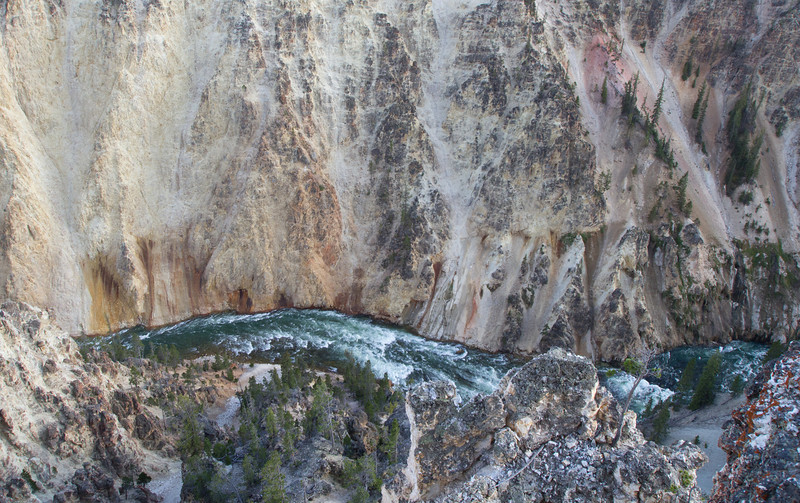 The river flows north through really colorful canyons.