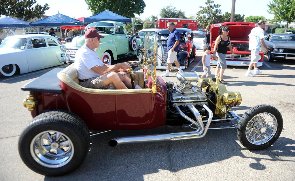 . A Roadster drives through the car show during the 4th annual La Habra Highlanders car show at La Habra High School in La Habra Calif. on Saturday, Sept. 7, 2013.   (Photo by Keith Birmingham/Pasadena Star-News)