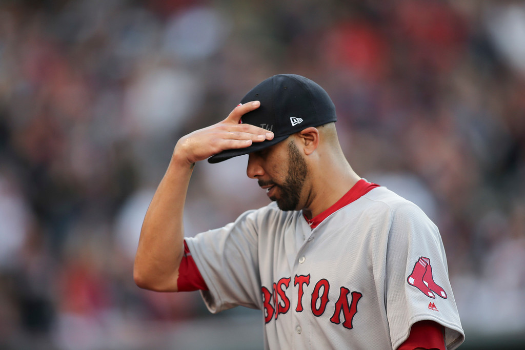. Boston Red Sox pitcher David Price walks off the field after being removed during the fourth inning against the Cleveland Indians in Game 2 of a baseball American League Division Series, Friday, Oct. 7, 2016, in Cleveland. (AP Photo/Aaron Josefczyk)