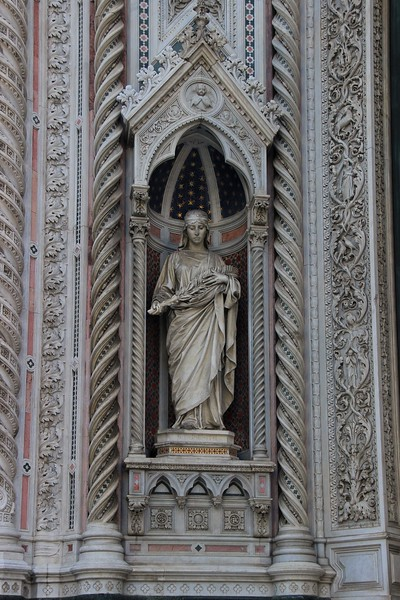 This statue on the Duomo facade is of Saint Reparata, the namesake of the church which stood on this site before this cathedral was built.