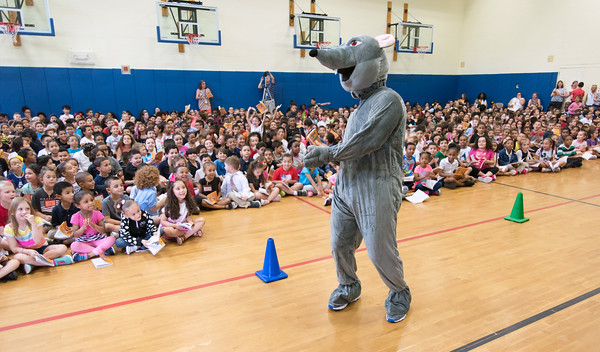 06/01/18 Wesley Bunnell | Staff Lincoln Elementary School students are entertained by a mouse on Friday afternoon in the school gymnasium. The school held their One School, One Book event on Friday afternoon giving every student the same book, The Mouse on the Motorcycle, to bring home to be read with their parents. The books were wrapped with the title kept a secret until being passed out.