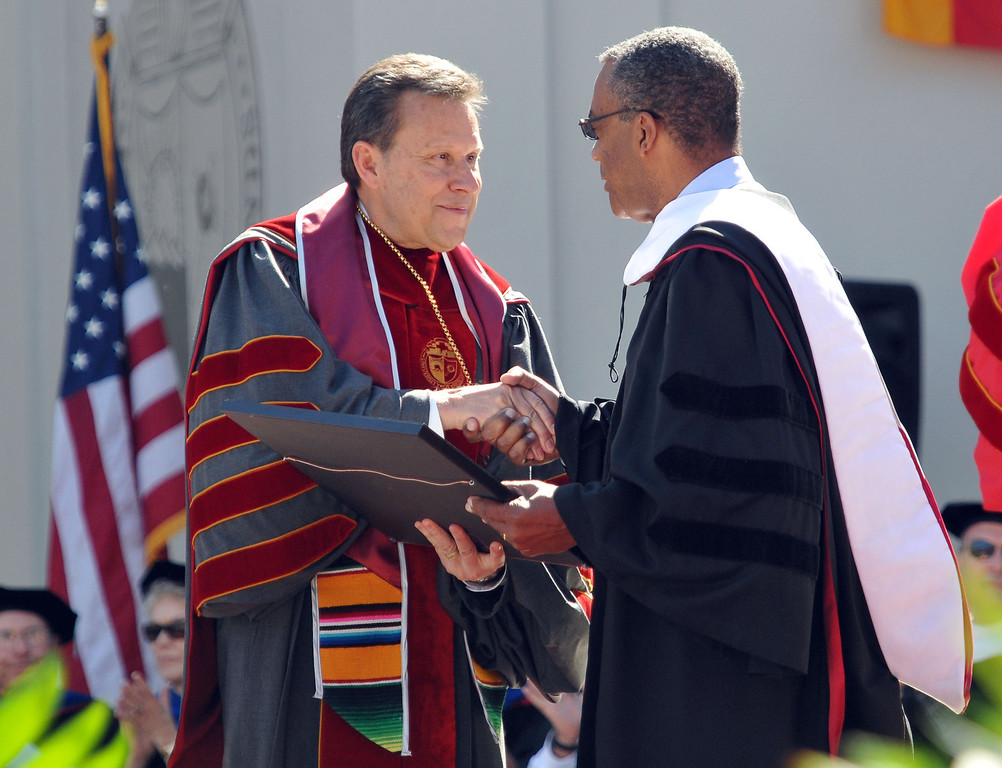 """. (John Valenzuela/Staff Photographer)   University president Ralph Kuncl congratulates Jon Robertson after he receives an honorary doctorate during The 104th College of Arts & Sciences Commencement for the University of Redlands, Saturday, April 20, 2013. University of Redlands alumni, Marilyn Magness Carroll,  delivered the Commencement speech, \"""" If You Can Dream It, You can Do It\""""."""