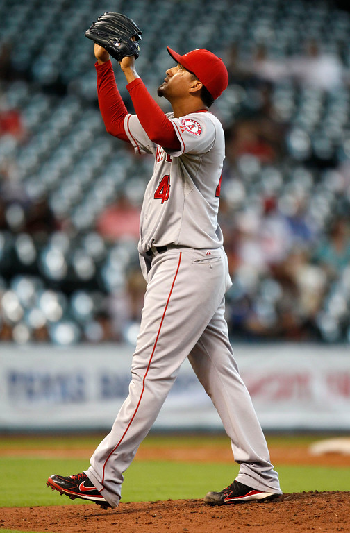 . Los Angeles Angels relief pitcher Ernesto Frieri celebrates the Angels\' 2-1 victory over the Houston Astros in a baseball game Sunday, Sept. 15, 2013, at Minute Maid Park in Houston. (AP Photo/Eric Christian Smith)