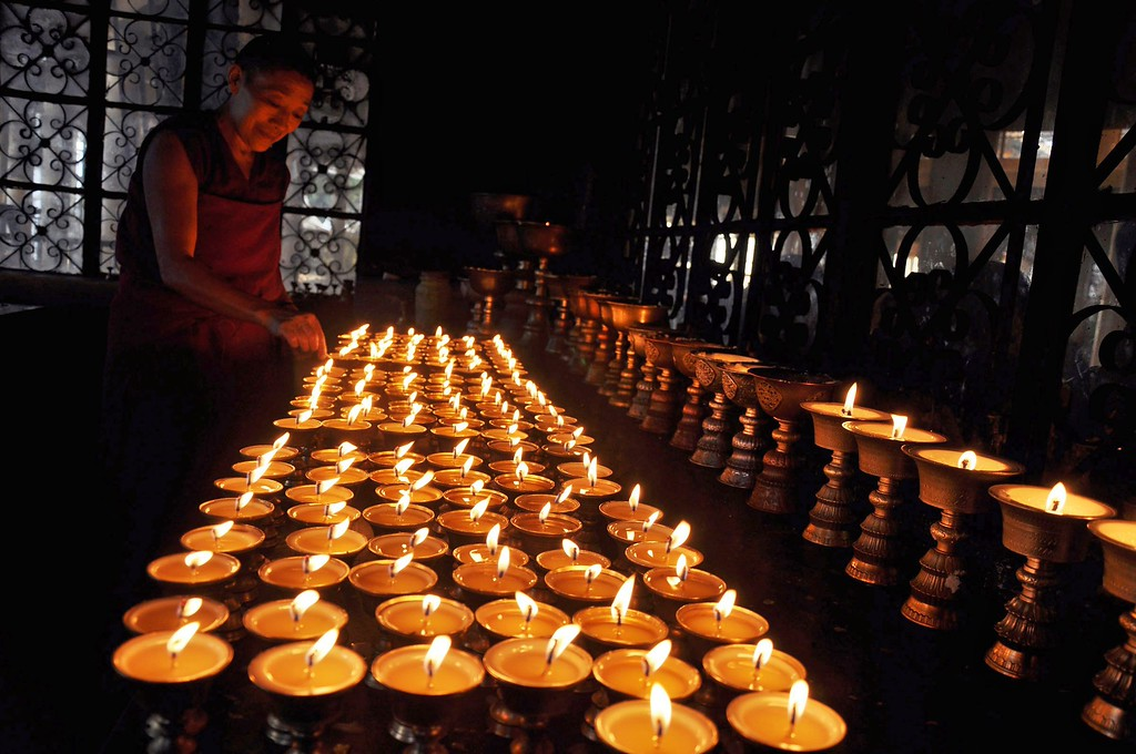 . Prayer lamps are seen lit during a prayer meeting held by the Tibetan government in-exile, dedicated to Nelson Mandela and Tibetan self immolator Kunchok Tseten who died after a self immolation protest in Tibet recently at the main Tibetan Tsuglagkhang Temple at McLeod Ganj near Dharamsala, India, 07 December 2013. Nobel Peace Prize winner Nelson Mandela died at age 95, in Johannesburg, South Africa, on 05 December 2013. A former lawyer, Mandela was the first black President of South Africa voted into power after the countries first free and fair democratic elections that witnessed the end of the Apartheid system in 1994. Mandela was founding member of the ANC (African National Congress) and anti-apartheid activist who served 27 years in prison, spending many of these years on Robben Island. In South Africa, Mandela is often known as Tata Madiba, an honorary title adopted by elders of Mandela\'s clan. Mandela won the Nobel Peace Prize in 1993.  EPA/SANJAY BAID