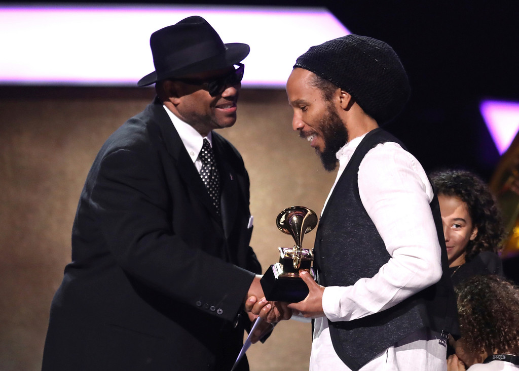 ". Jimmy Jam, left, presents Ziggy Marley with the award for best reggae album for ""Ziggy Marley\"" at the 59th annual Grammy Awards on Sunday, Feb. 12, 2017, in Los Angeles. (Photo by Matt Sayles/Invision/AP)"