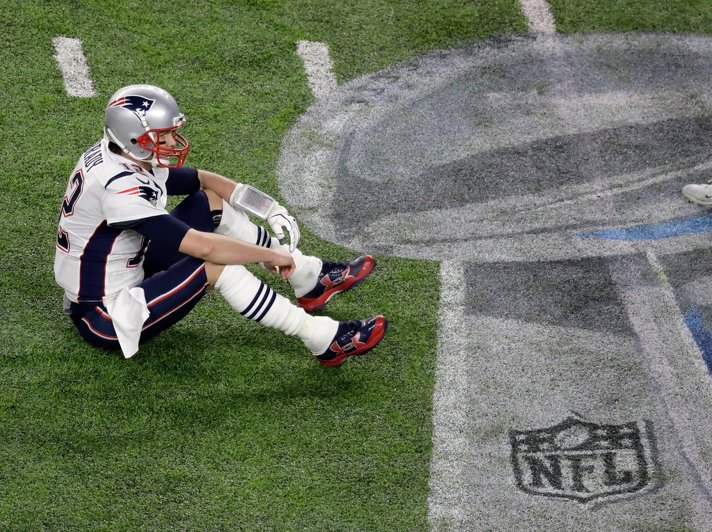 . New England Patriots quarterback Tom Brady sits on the field after fumbling against the Philadelphia Eagles during the second half of the NFL Super Bowl 52 football game Sunday, Feb. 4, 2018, in Minneapolis. (AP Photo/Eric Gay)