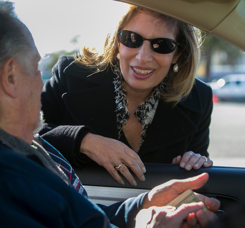. Congresswoman Jackie Speier (D-San Francisco/San Mateo), talks to a man after giving him cash for the guns her handed over in a gun buyback Saturday at the San Mateo County Event Center. People got up to $100 cash for a hand gun, shotgun or rifle, and up to $200 cash for an assault weapon. (John Green/Staff)