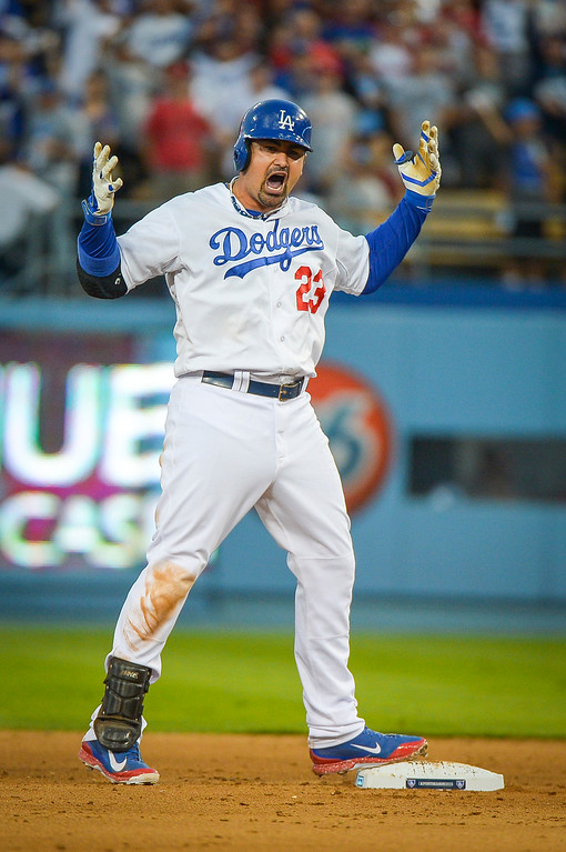 . Dodgers\' Adrian Gonzalez screams to his teammates after he connected for a double against the Cardinals in NLCS game 3 at Dodger stadium Monday, October 14, 2013 ( Photo by Andy Holzman/Los Angeles Daily News )