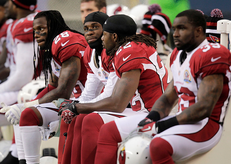 . Arizona Cardinals players sit on the bench during the second half of an NFL football game against the Seattle Seahawks in Seattle, Sunday, Dec. 9, 2012. (AP Photo/Stephen Brashear)