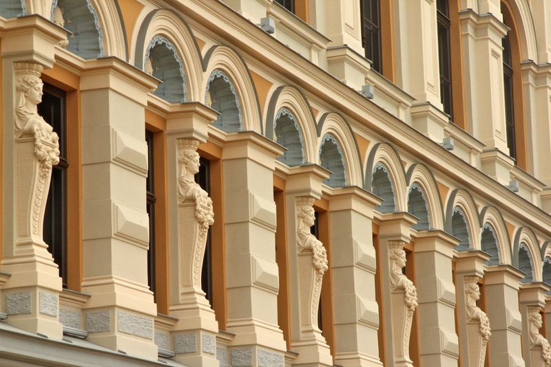 Intricate facade of a building on Livu Square in Old Town -Riga, Latvia