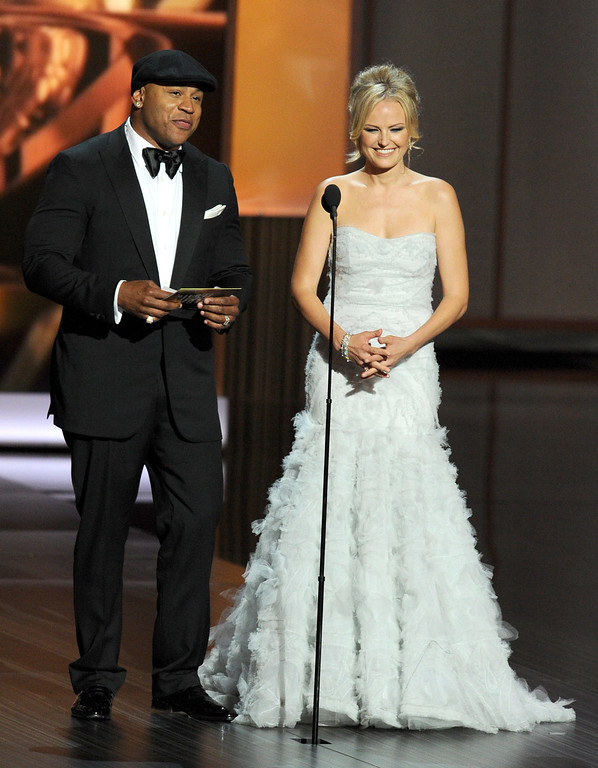 . Presenters LL Cool J and Malin Akerman speak onstage during the 65th Annual Primetime Emmy Awards held at Nokia Theatre L.A. Live on September 22, 2013 in Los Angeles, California.  (Photo by Kevin Winter/Getty Images)
