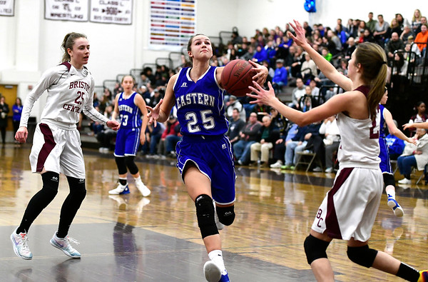 1/17/2019 Mike Orazzi | Staff Bristol Eastern's Sage Scarritt (25) and Bristol Central's Ella Watson (23) during Thursday night's girls basketball game with at BC.