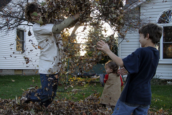 10-29-10 Grandkids in Leaves