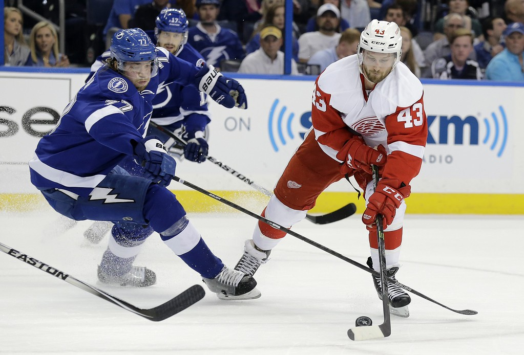 . Detroit Red Wings center Darren Helm (43) gets around Tampa Bay Lightning defenseman Victor Hedman (77), of Sweden, during the first period of Game 7 of a first-round NHL Stanley Cup hockey playoff series Wednesday, April 29, 2015, in Tampa, Fla. (AP Photo/Chris O\'Meara)