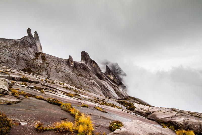 The donkey ear peaks (4054 m) and Tunku Abdul Rahman Peak (3948 m). Eastern plateau of Mt Kinabalu, Borneo. As seen from Sayat-Sayat checkpoint on the slope to the summit. Mount Kinabalu Borneo