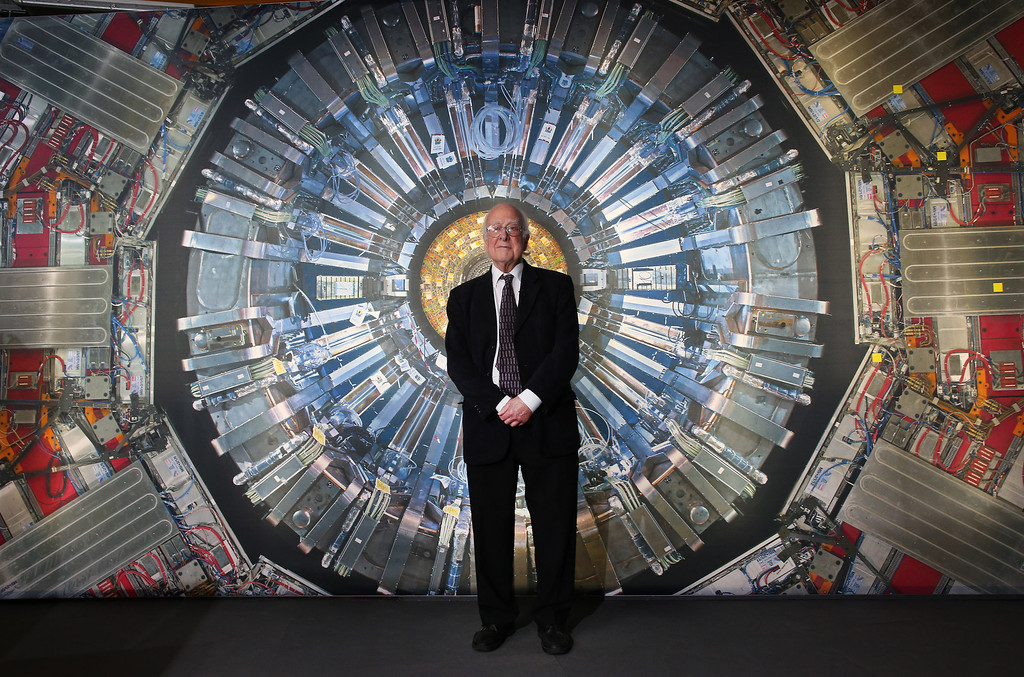. Professor Peter Higgs stands in front of a photograph of the Large Hadron Collider at the  Science Museum\'s \'Collider\' exhibition on November 12, 2013 in London, England. (Photo by Peter Macdiarmid/Getty Images)