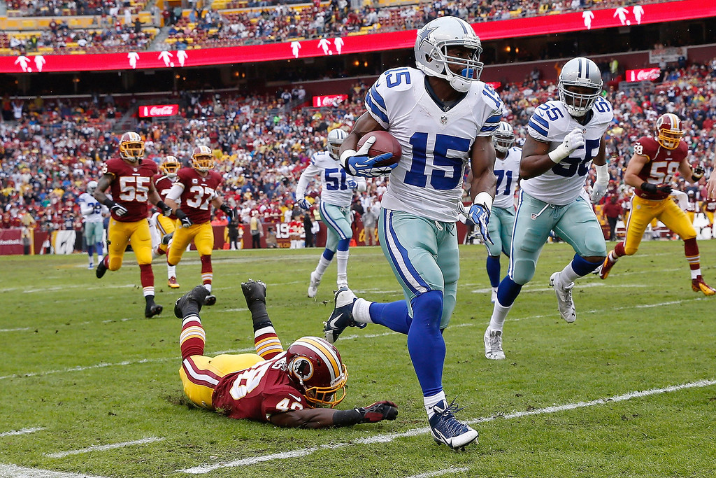 . Dallas Cowboys wide receiver Micheal Spurlock (15) leaves Washington Redskins strong safety Jose Gumbs on the turf while returning a punt during the first half of an NFL football game in Landover, Md., Sunday, Dec. 22, 2013. (AP Photo/Alex Brandon)