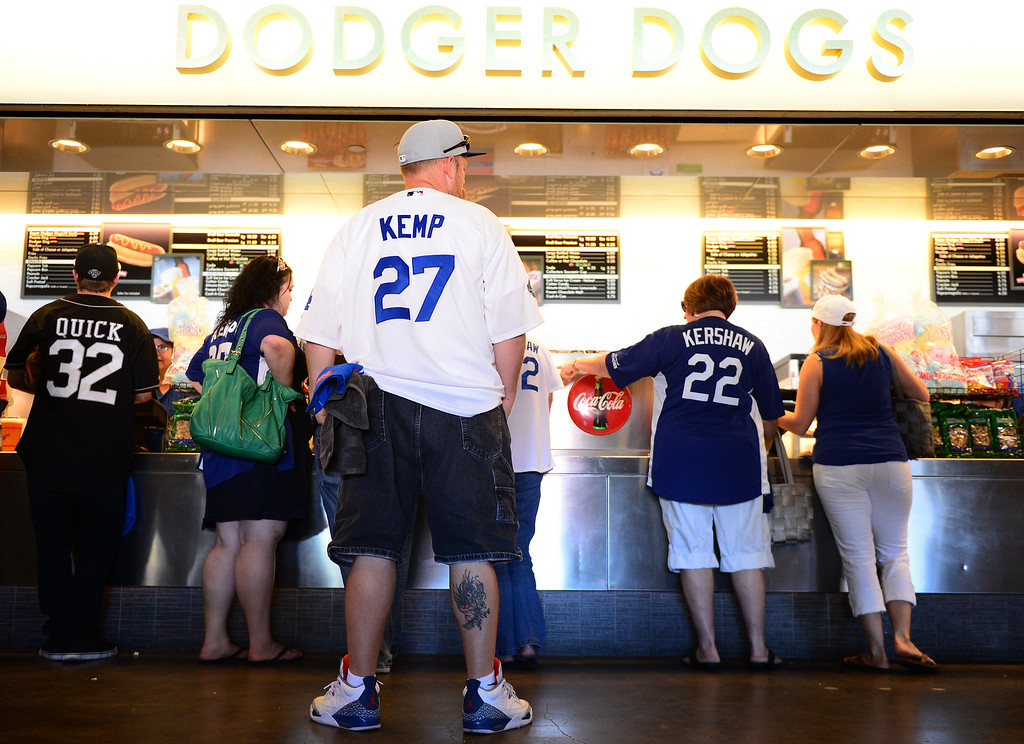 . People get ready for the Dodgers vs Brave\'s game 3 of the NLDS at Dodger Stadium, Sunday, October 6, 2013. (Photo by Sarah Reingewirtz/Los Angeles Daily News)