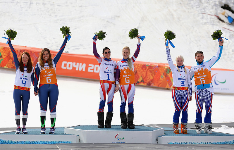 . (L-R) Silver medalist Jade Etherington of Great Britain and guide Caroline Powell, gold medallist Henrieta Farkasova of Slovakia and guide Natalia Subrtova and bronze medalist Aleksandra Frantceva of Russia and guide Aleksandra Frantceva  wave during the flower ceremony for the Women\'s Downhill - Visually Impaired during day one of Sochi 2014 Paralympic Winter Games at Rosa Khutor Alpine Center on March 8, 2014 in Sochi, Russia.  (Photo by Ian Walton/Getty Images)