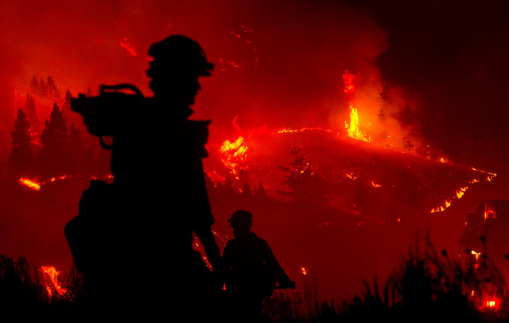 . Firefighters light a back burn near Pine, Idaho while fighting the Elk fire Wednesday Aug. 14, 2013.   (AP Photo/Idaho Statesman, Kyle Green)