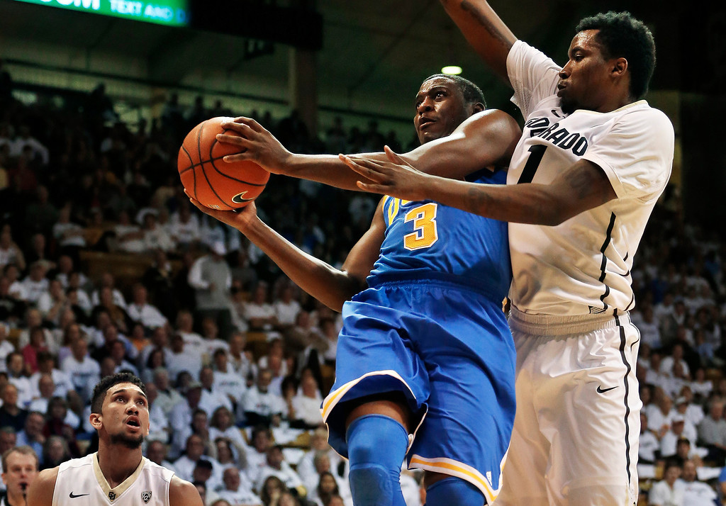 . UCLA\'s Jordan Adams (3) prepares to shoot as Colorado\'s Wesley Gordon, right, defends during the first half of an NCAA college basketball game in Boulder, Colo., Thursday, Jan. 16, 2014. (AP Photo/Brennan Linsley)