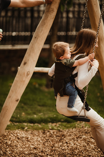 Izmi_Baby_Carrier_Olive_Lifestyle_Back_Carry_Swing_Behind.jpg