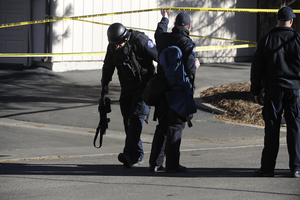 . Police work at the scene where a gunman killed four people  at a townhome complex near Ithaca Place and Kittredge Street in Aurora Saturday morning. Four poeple were killed including the shooter. Andy Cross, The Denver Post