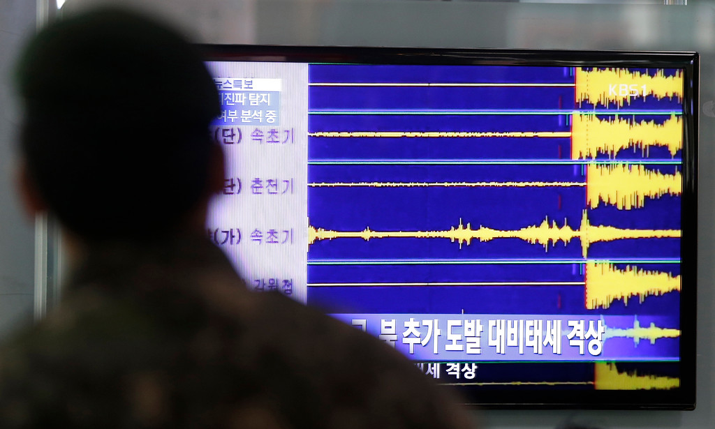 . A South Korean soldier watches a TV screen reporting seismic waves of North Korea\'s nuclear test at Seoul train station in Seoul, South Korea, Tuesday, Feb. 12, 2013.  Defying U.N. warnings, North Korea on Tuesday conducted an underground nuclear test in the remote, snowy northeast, taking a crucial step toward its goal of building a bomb small enough to be fitted on a missile capable of striking the United States. (AP Photo/Lee Jin-man)