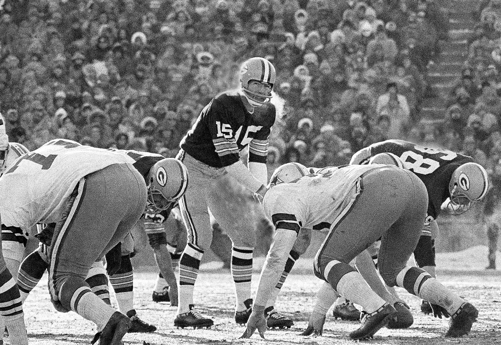 . FILE - In this Dec. 31, 1967, file photo, Green Bay Packers quarterback Bart Starr calls signals in bitter cold as he led the Packers to a 21-14 win over the Dallas Cowboys to capture third consecutive National Football League title in Green Bay, Wisc. In the history of NFL games, none stands out for the brutal conditions in which it was played like the NFC championship on the last day of 1967. Simply dubbed the Ice Bowl, those who participated in Cowboys-Packers that day at Lambeau Field still shiver when talking about it. (AP Photo/File)