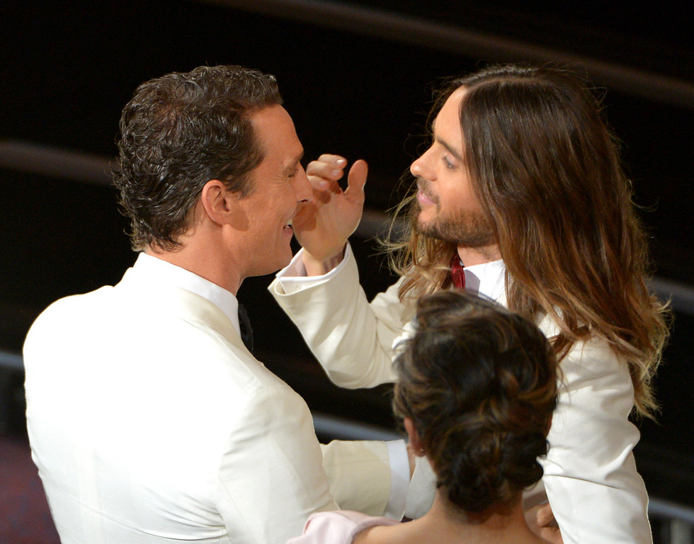 . Matthew McConaughey, left, congratulates Jared Leto in the audience during the Oscars at the Dolby Theatre on Sunday, March 2, 2014, in Los Angeles.  (Photo by John Shearer/Invision/AP)