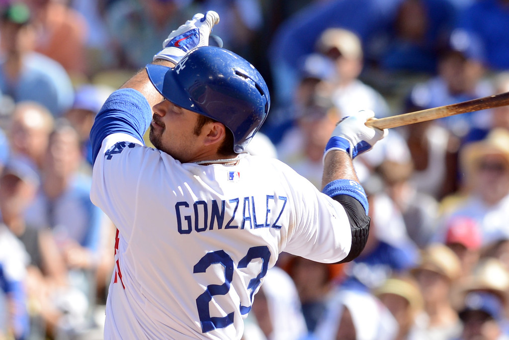 . The Dodgers\' Adrian Gonzalez hits a homerun int he 3rd inning against the Cardinals in game 5 of the NLCS at Dodger Stadium Wednesday, October 16, 2013.(David Crane/Los Angeles Daily News)